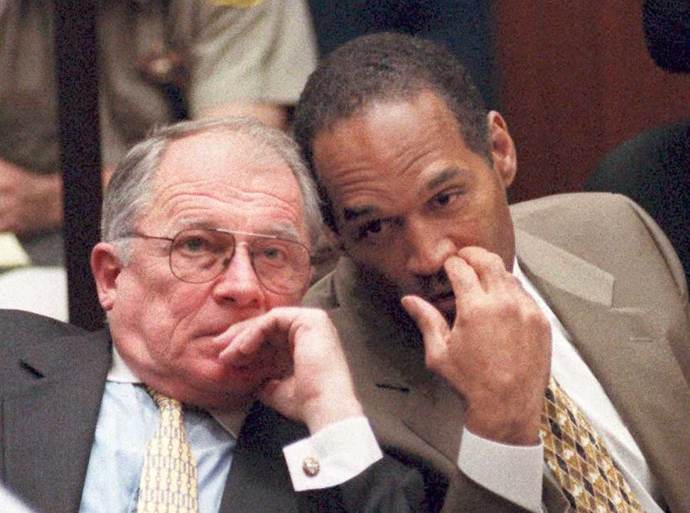 F. Lee Bailey huddles with O.J. Simpson