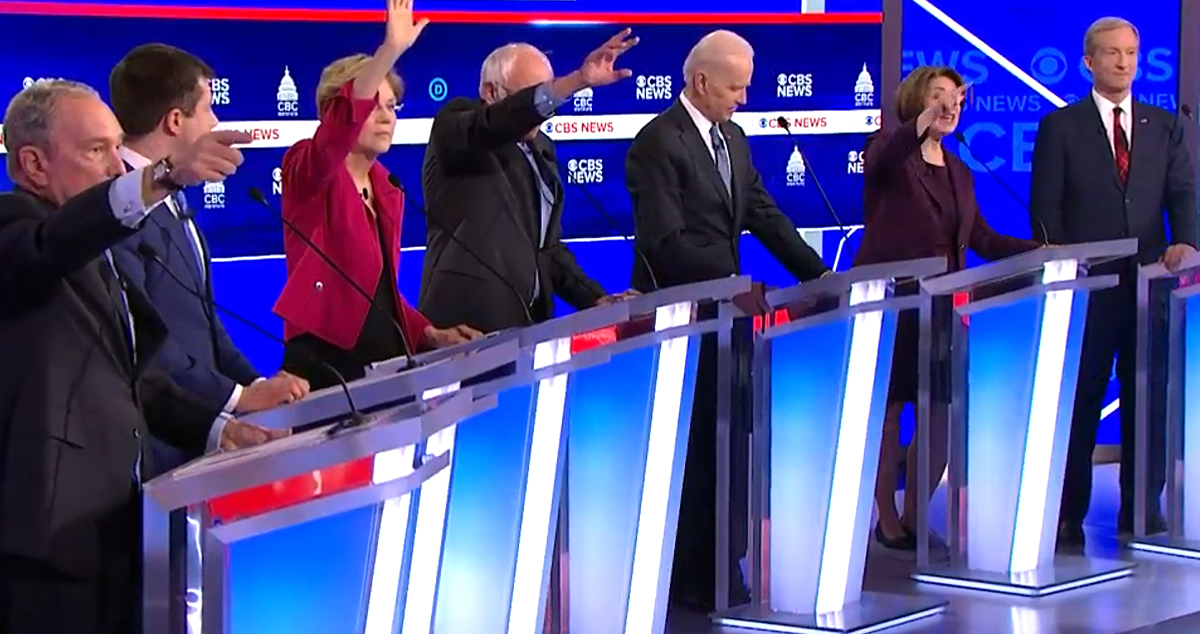 Democrats raise their hands attempting to speak in chaotic Democratic Debate (via screenshot)