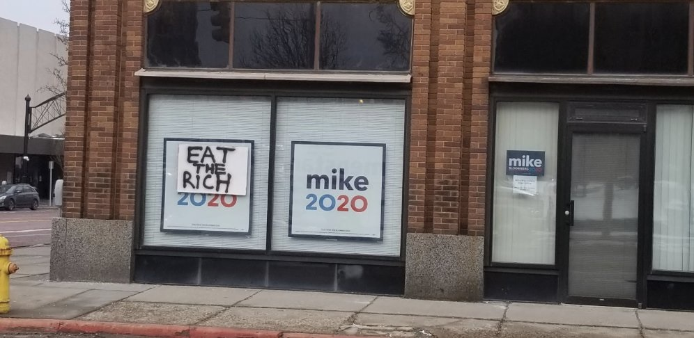 Bloomberg Criticized For Complaining About 'Eat the Rich' Sign in Flint, Michigan