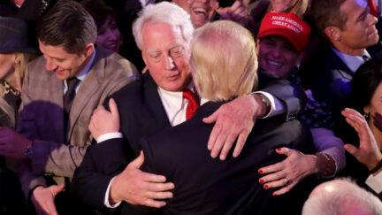 Donald Trump hugs his brother Robert Trump