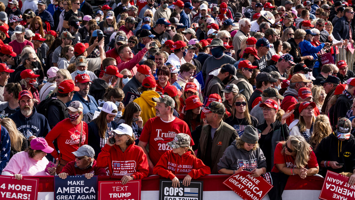 Mostly maskless supporters gather before President Donald Trump arrives for a rally at the Bemidji Regional Airport on September 18, 2020 in Bemidji, Minnesota.