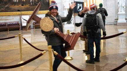 Adam Johnson, looting House Speaker Nancy Pelosi's lectern from Capitol