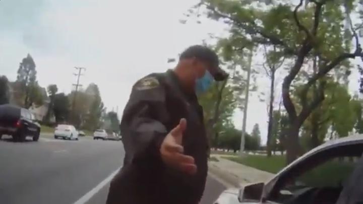 Racist Karen goes wild on police officer