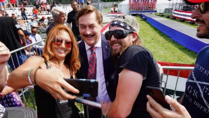 WELLINGTON, OHIO - JUNE 26: Supporters of former President Donald Trump take a selfie with My Pillow founder Mike Lindell as they wait for the start of a rally at the Lorain County Fairgrounds on June 26, 2021 in Wellington, Ohio. Trump is in Ohio to campaign for his former White House advisor Max Miller. Miller is challenging incumbent Rep. Anthony Gonzales in the 16th congressional district GOP primary. This is Trump's first rally since leaving office.