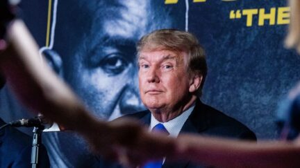 Former US President Donald Trump watches women dance as he hosts the Holyfield vs Belford boxing match live with commentary at Hard Rock Live in Hollywood, Florida on September 11, 2021.