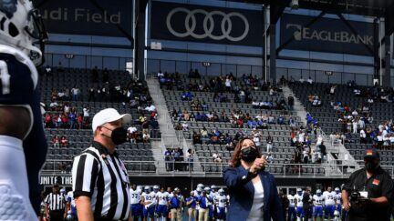 US Vice President Kamala Harris participates in the coin toss at the opening of the football game between Howard University and Hampton University at Audi Field in Washington, DC, on September 18, 2021. (Photo by Olivier DOULIERY / AFP) (Photo by OLIVIER DOULIERY/AFP via Getty Images)
