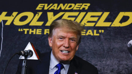 Trump poses before the Evander Holyfield fight, which was a box office fail