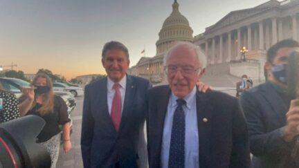 Joe Manchin and Bernie Sanders outside the Capitol