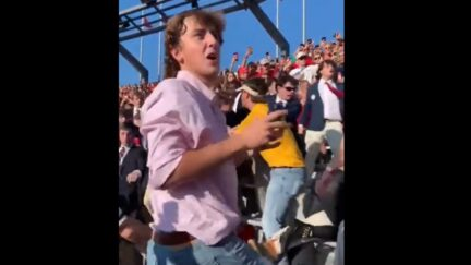 LSU fan protects his sunglasses during crowd fight